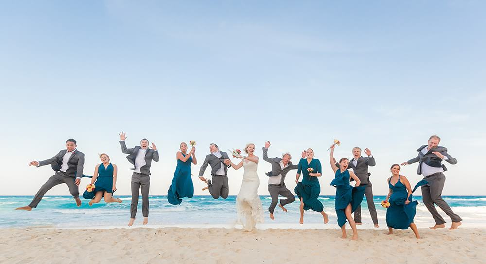 Wedding party jumping on Beach in Cancun