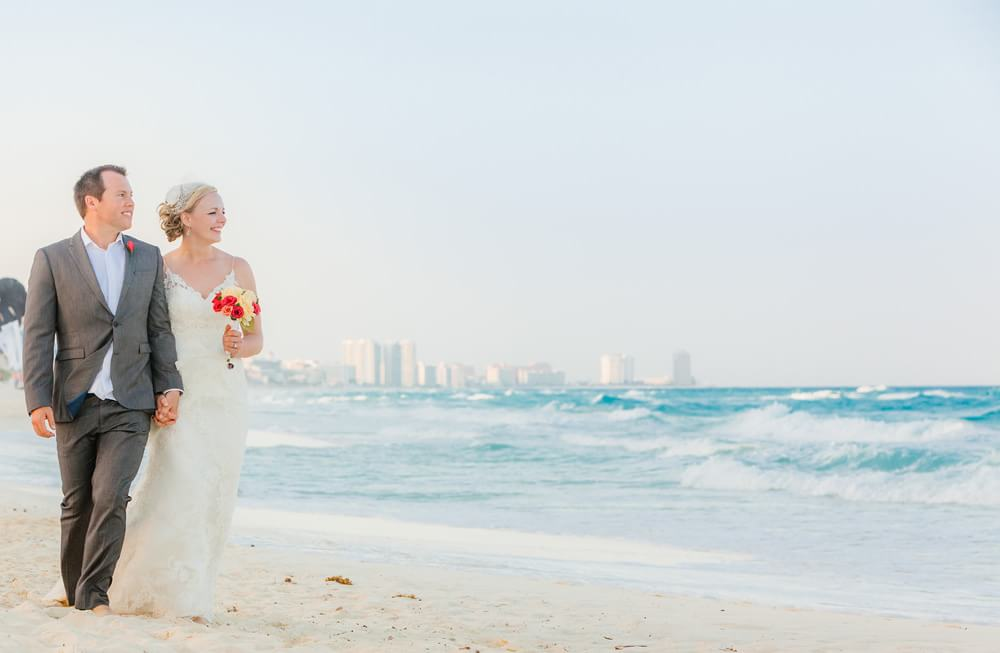 Wedding couple walking on beach in Cancun