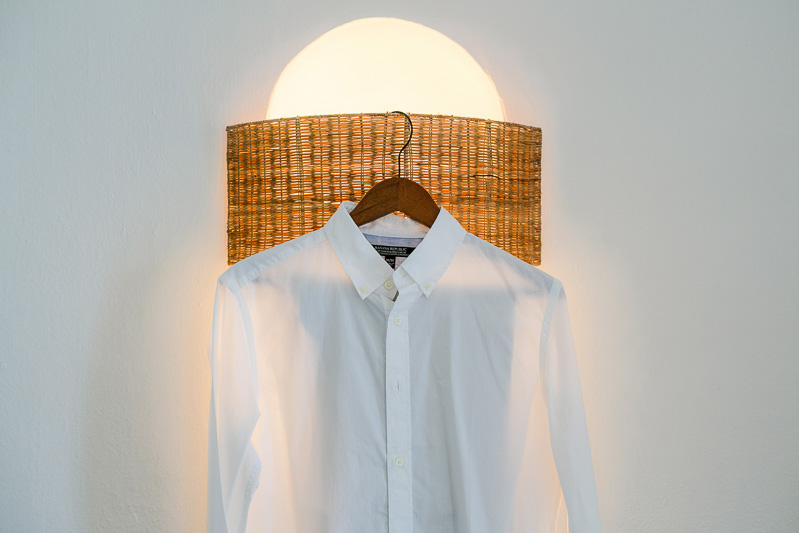 Grooms shirt hanging before wedding