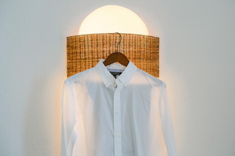 Grooms shirt hanging before wedding