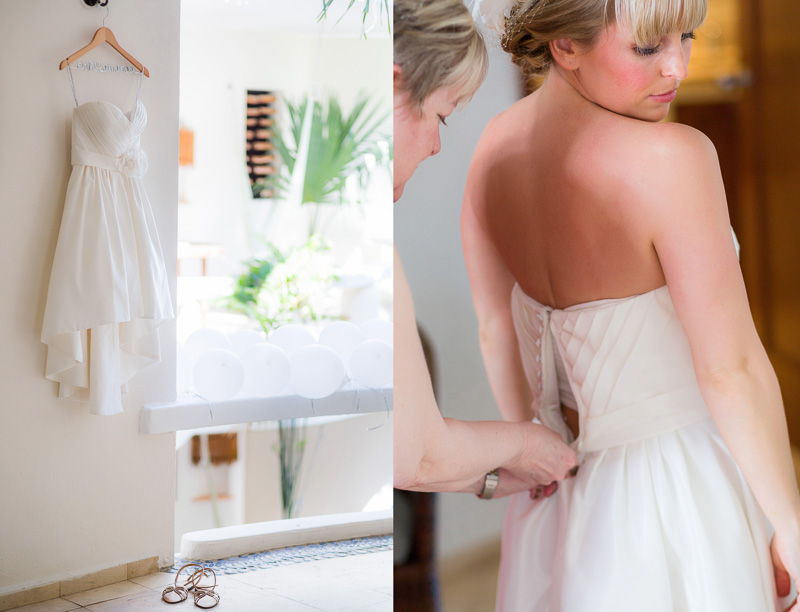 Brides mother helping bride put on dress before wedding