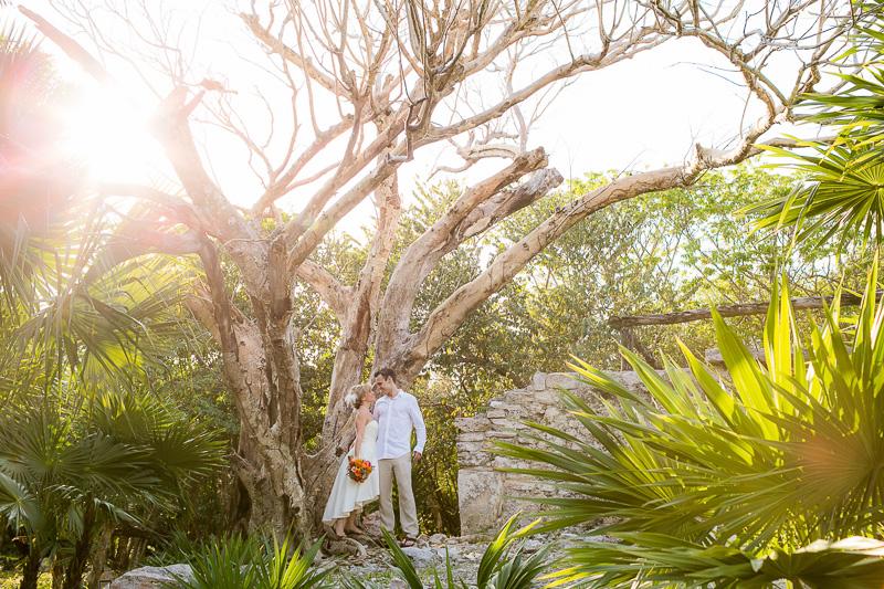 Bride and groom standing on ruins before wedding in Playa del Carmen