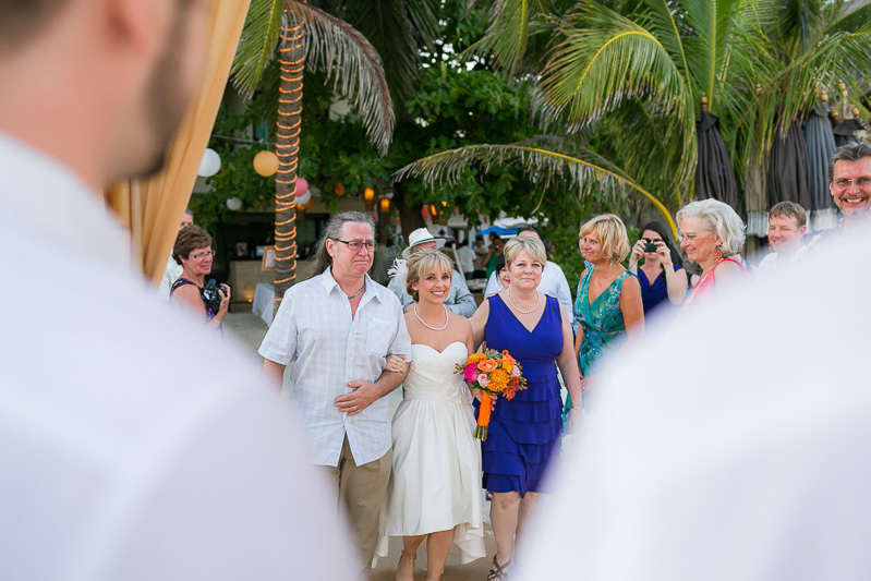 Bride and parents walking down aisle at wedding in Playa del carmen