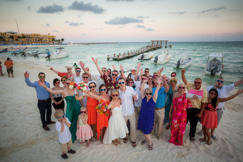 Group photograph of everyone at wedding on beach in Playa del carmen
