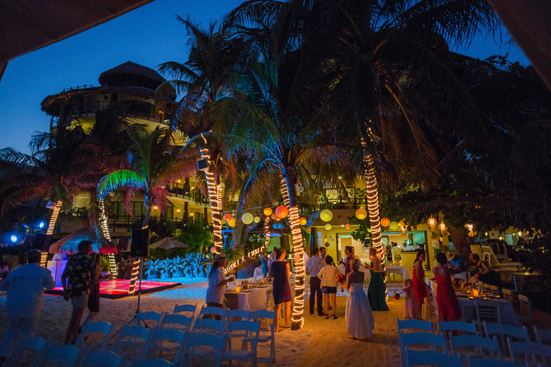 Guests dancing at wedding reception on beach in playa del carmen