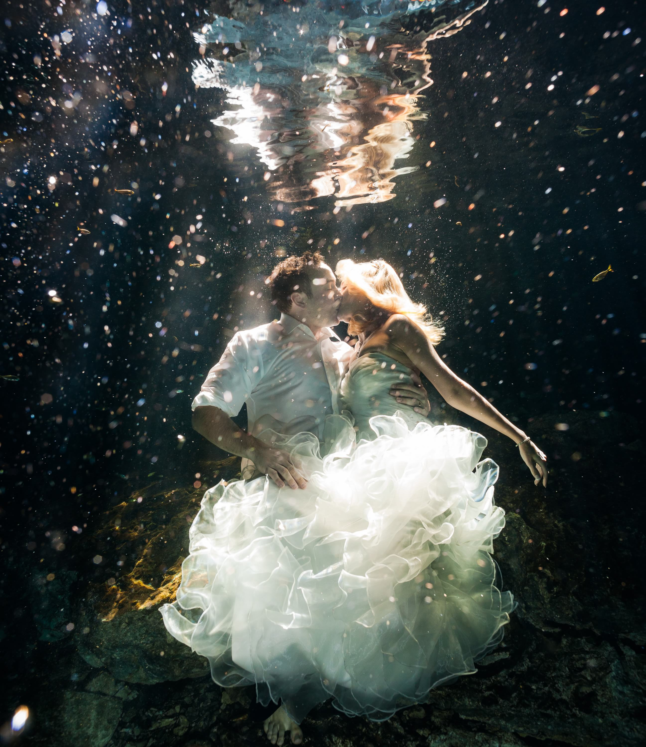 Underwater Trash the Dress wedding photograph in Mayan Cenote