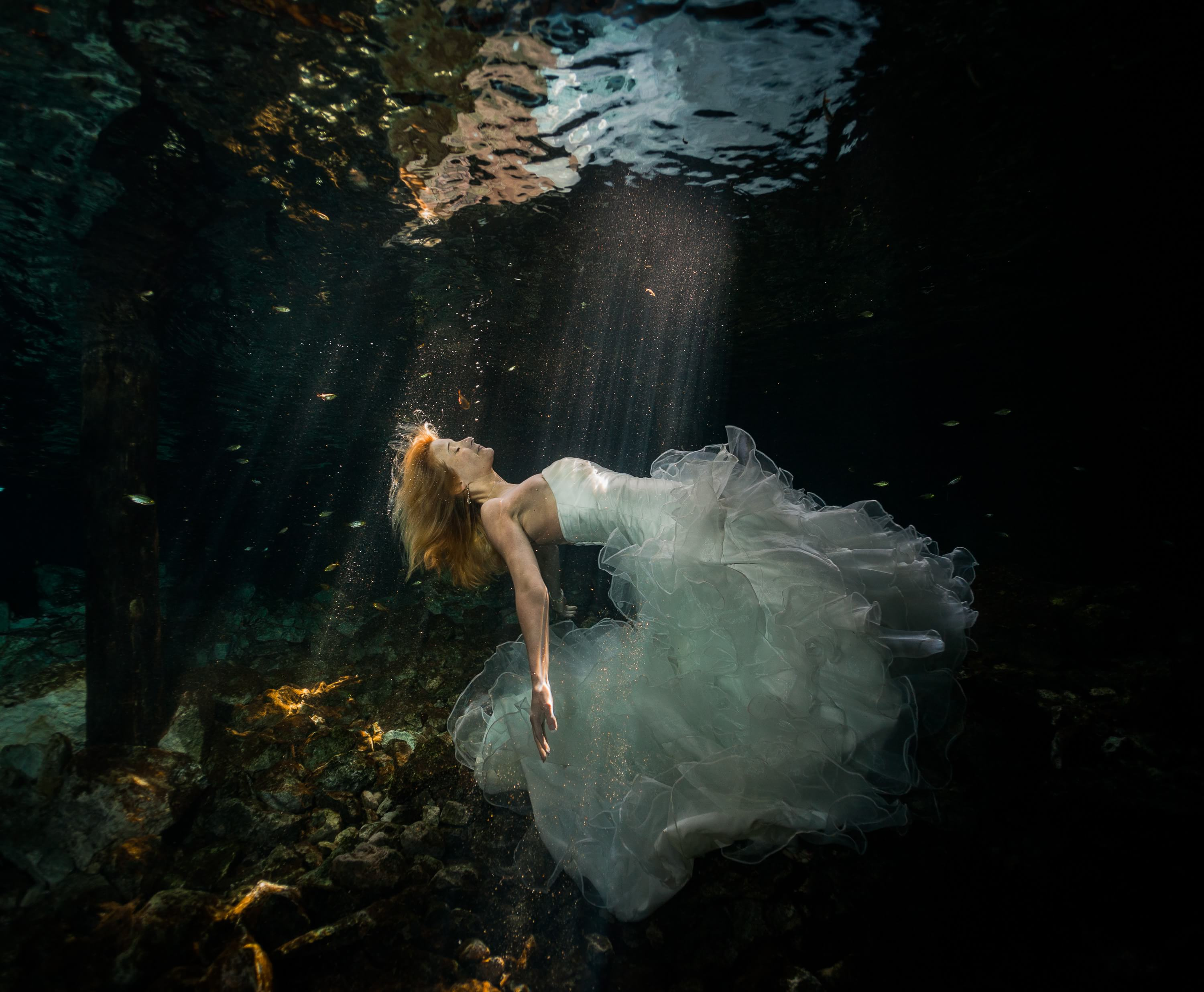 Bride underwater Mayan trash the dress wedding photograph