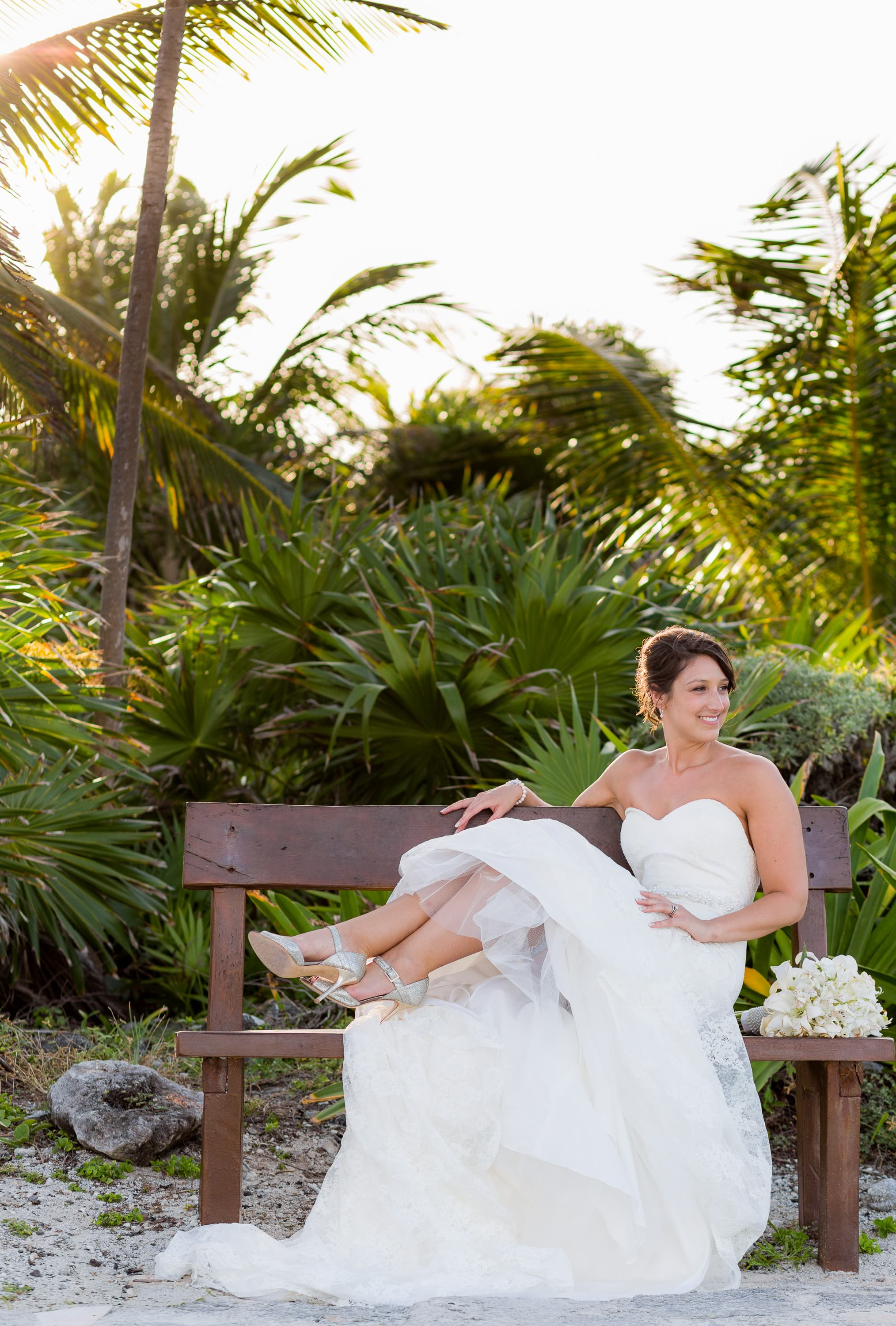 Bride sitting on bench at Grand Palladium Riviera Maya Wedding
