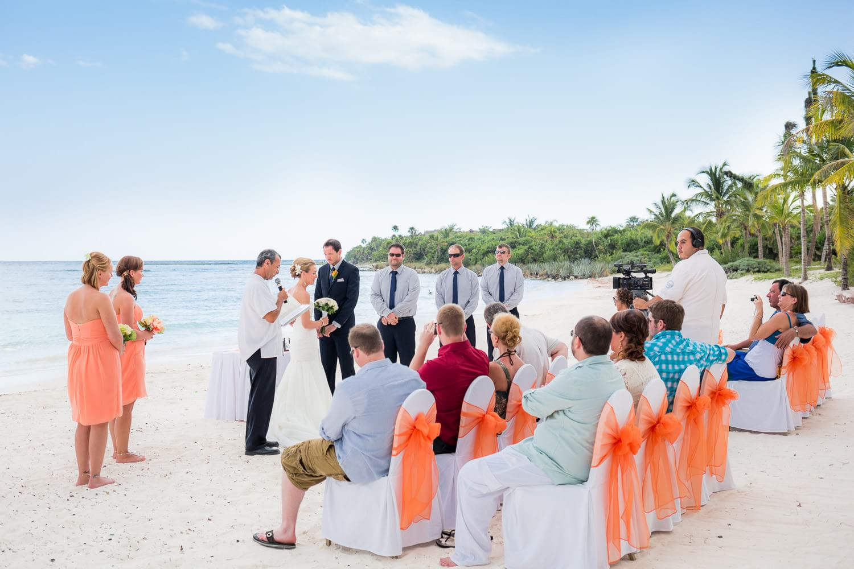 Wedding ceremony on beach at Barcelo Maya Rivera wedding.