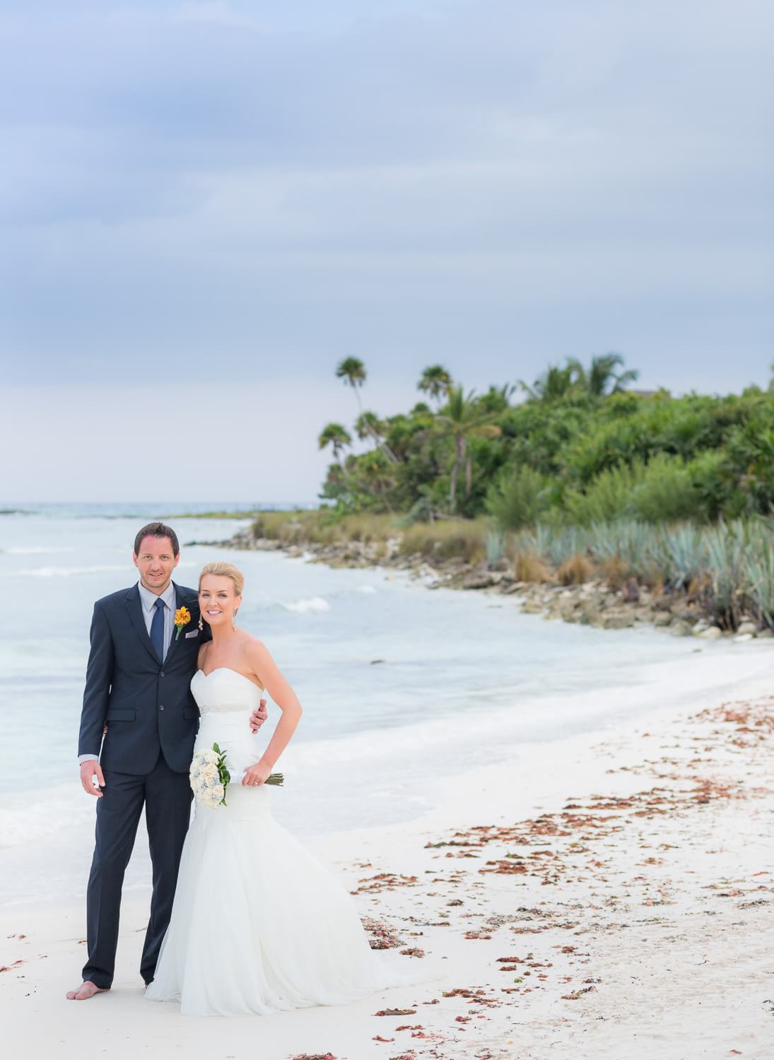 Portrait of couple on beach by Dean Sanderson, Mexico wedding photographer.