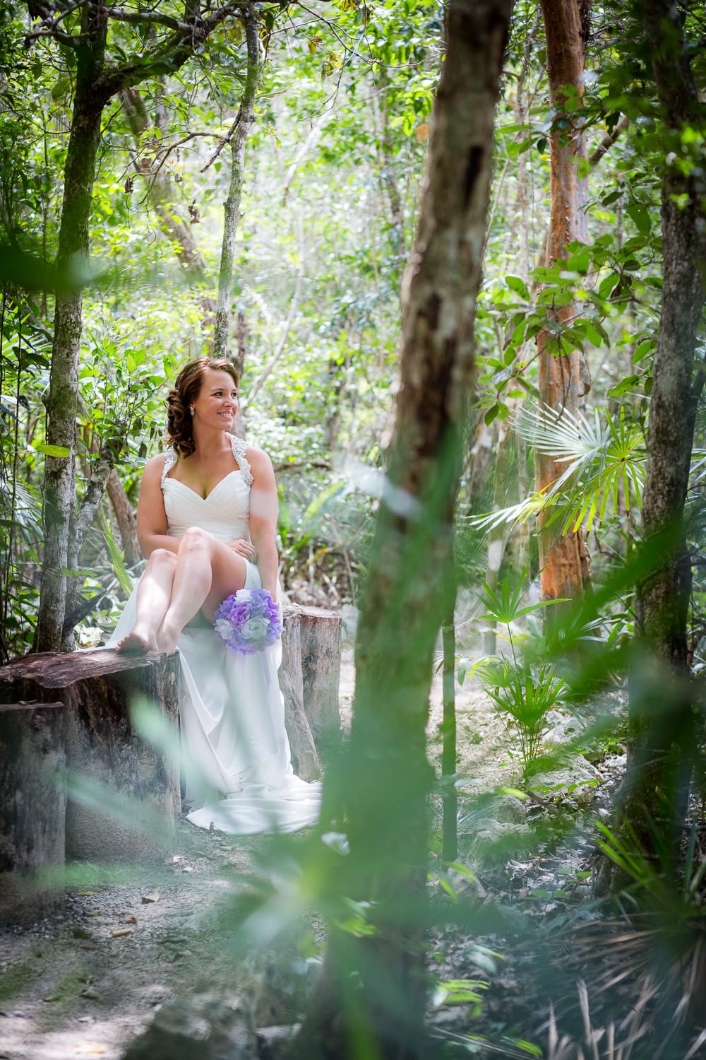 Bride in jungle at Trash the Dress