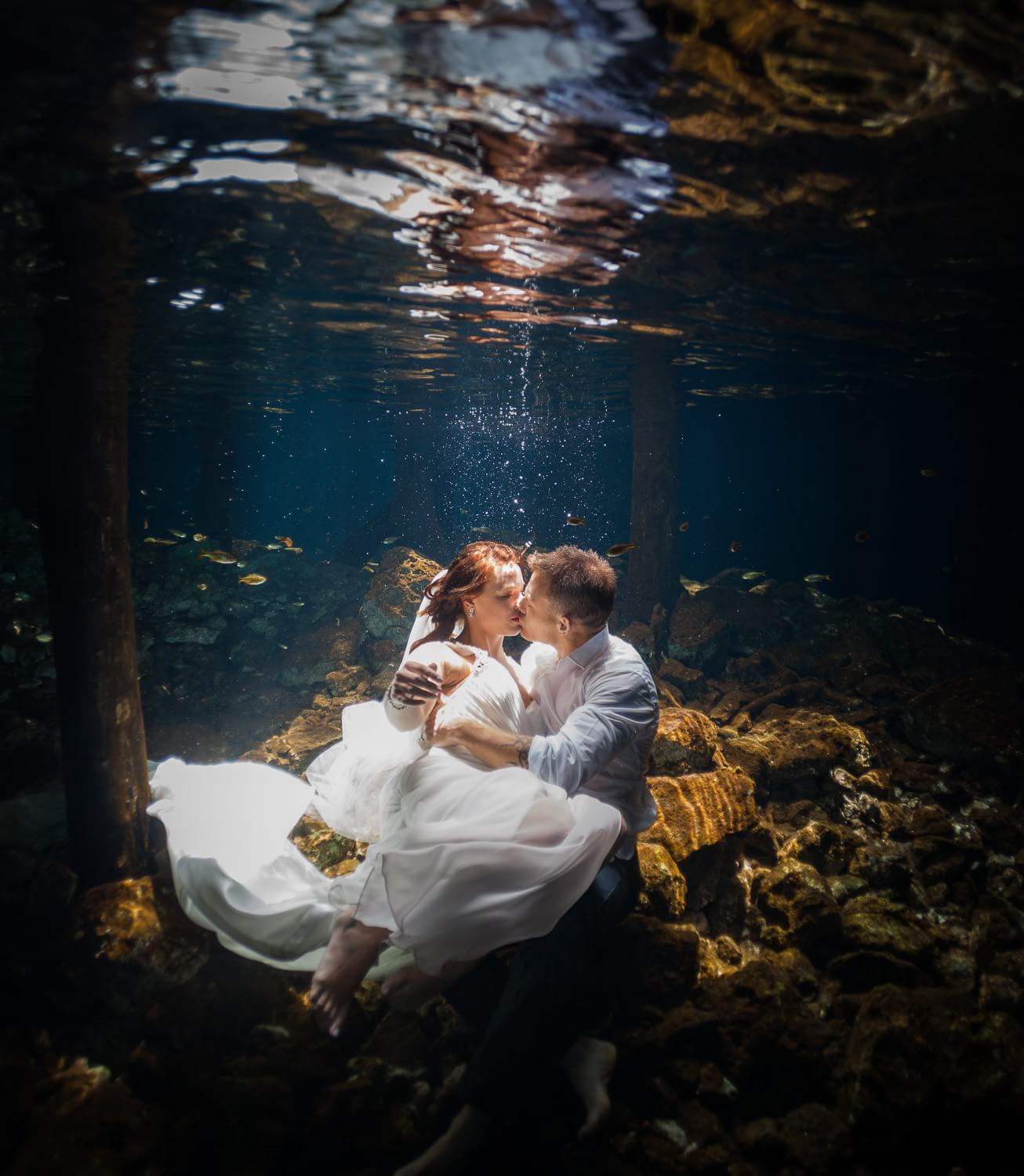 Couple in underwater Mayan Trash the Dress