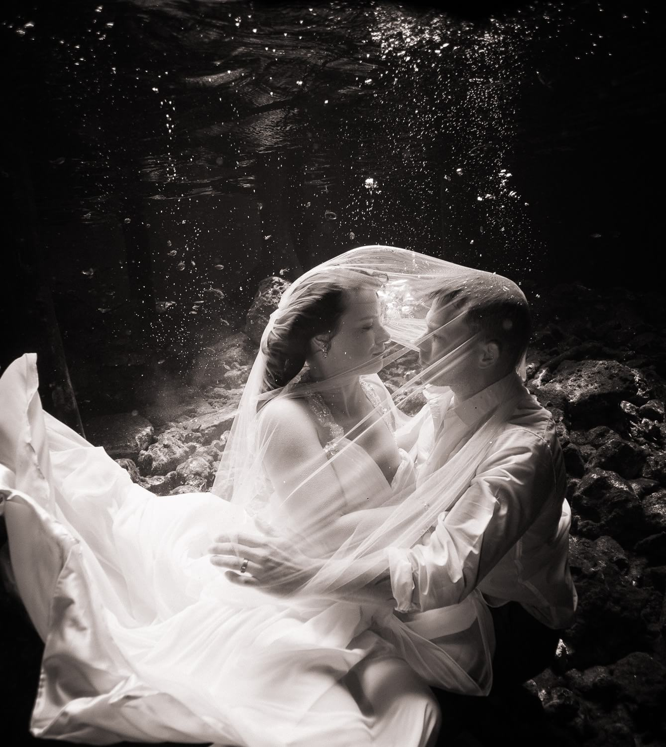 Couple under water in Mayan Trash the Dress