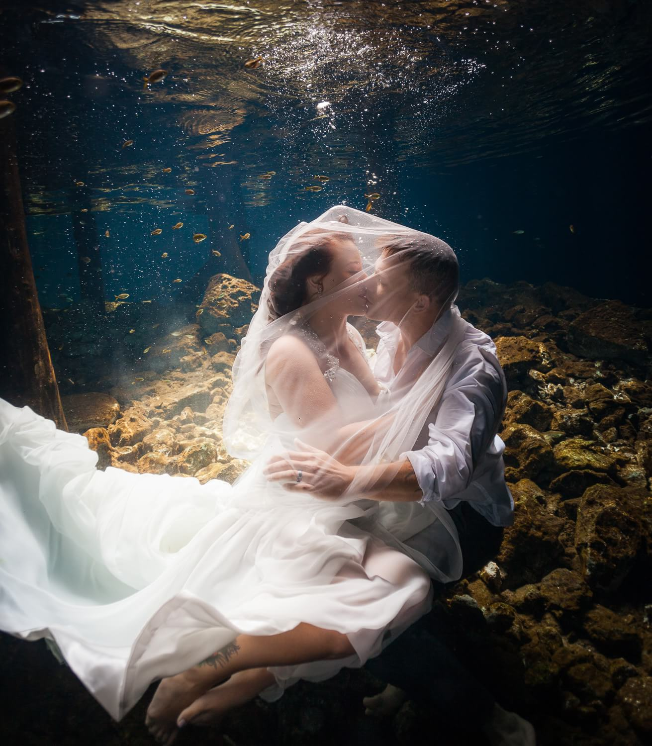 Couple kissing under Veil at Mayan Trash the Dress