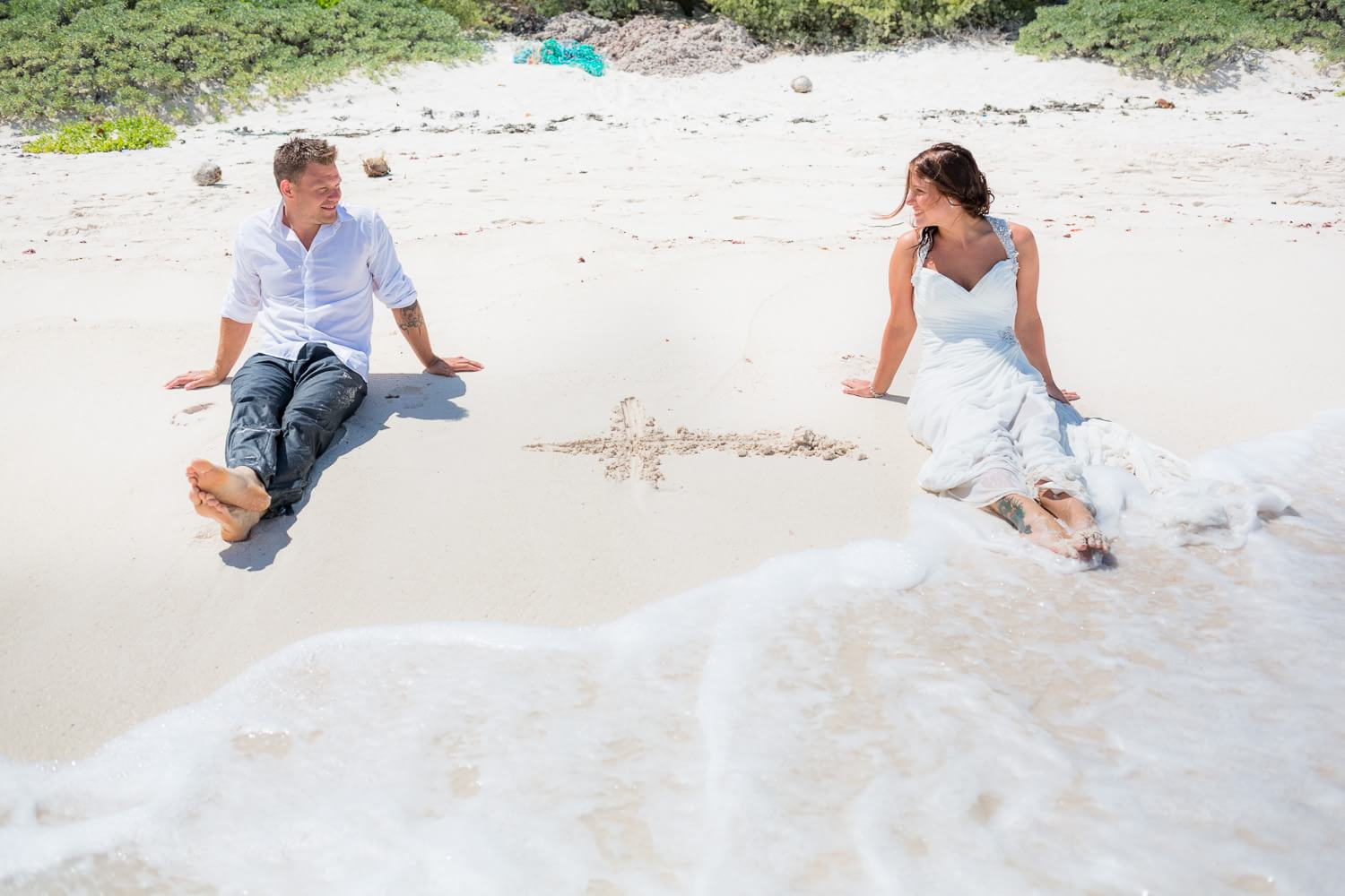 Cute photo of couple on beach in Riviera Maya with Plus sign