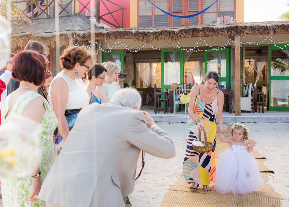 Flower girl walking down isle at Tulum weding