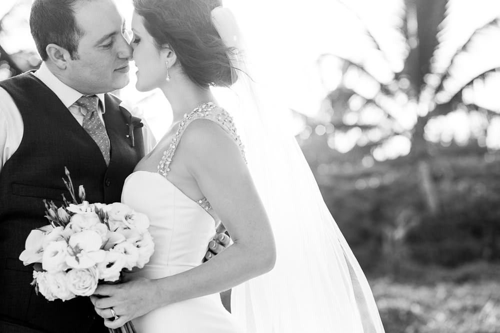 Bride and Groom kissing by wedding photographer
