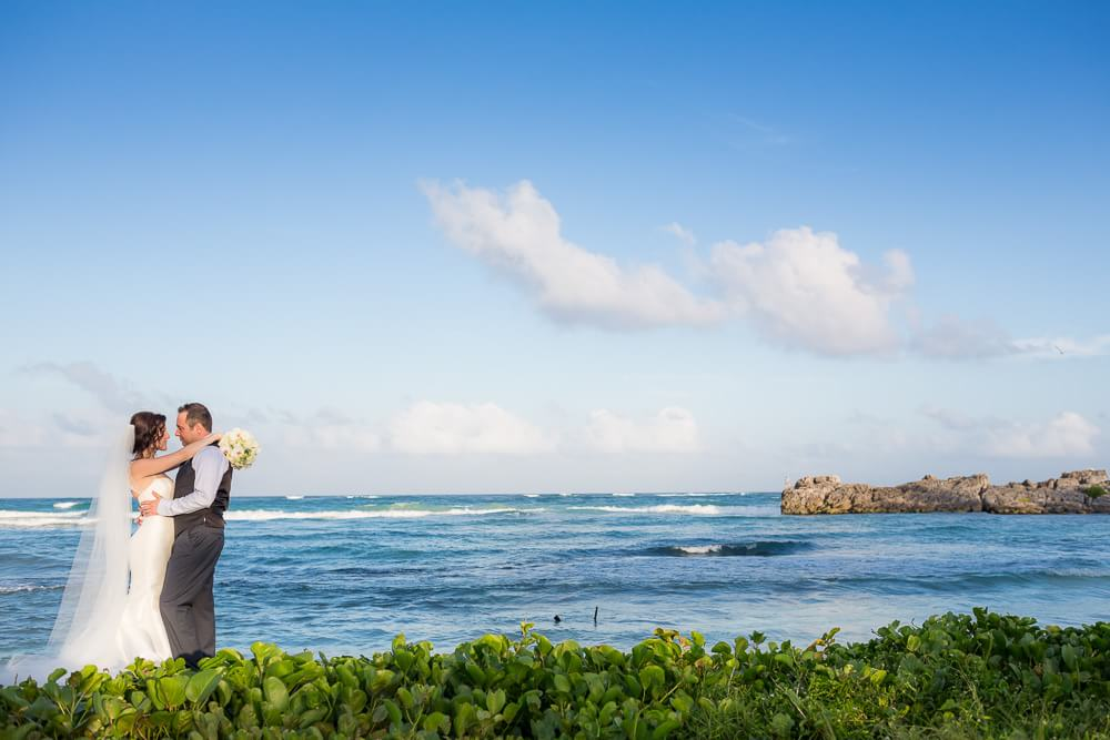 Bride and groom beside Sea in Tulum wedding