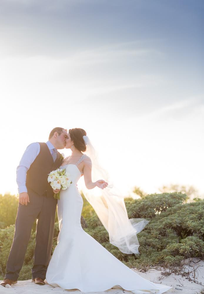 Couple kissing at Tulum wedding