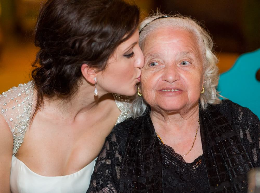 Bride kissing grandmother at Tulum wedding.