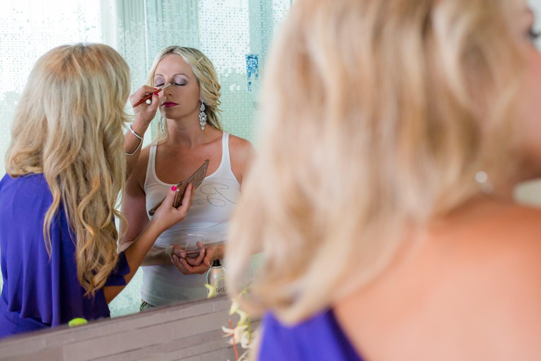 Bride in bathroom getting ready at Secrets the Vine Cancun Wedding