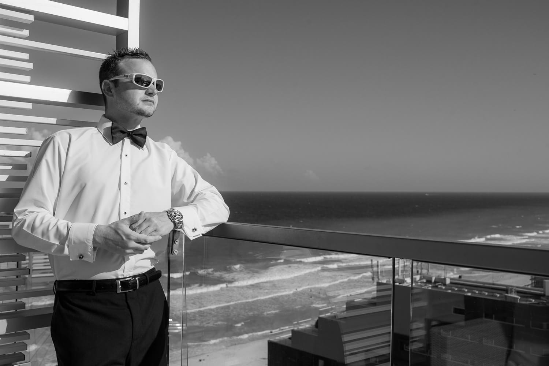 Portrait of groom on deck in cancun