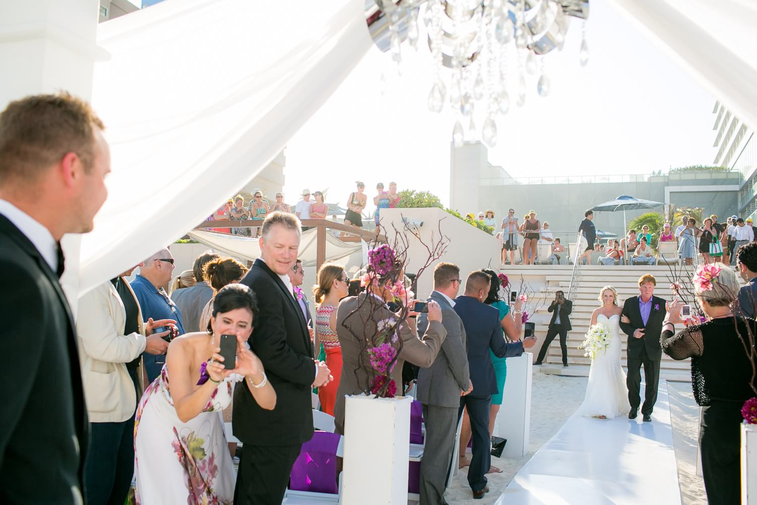 Bride walking down the isle at Secrets the vine Cancun wedding.