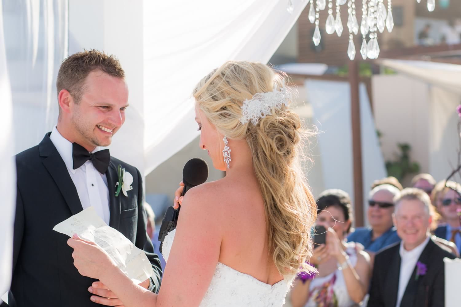 Couple giving vows at Secrets The Vine Cancun wedding