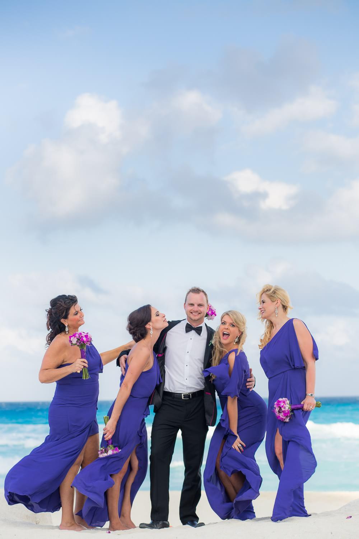 Bridesmaid and groom at fun Cancun wedding