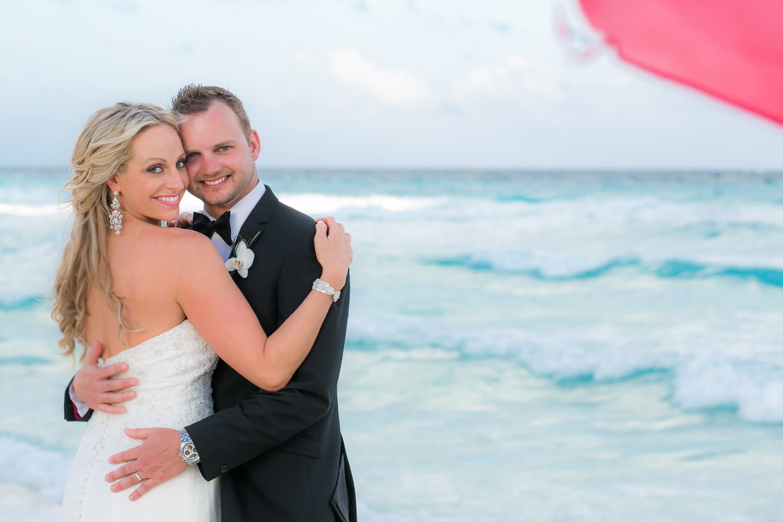 Couple on beach at cancun wedding