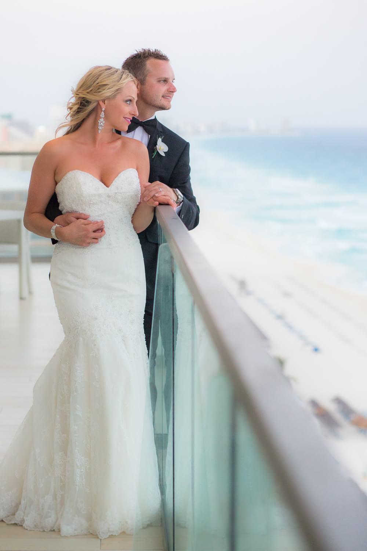 Couple on deck at Secrets the Vine Cancun Wedding