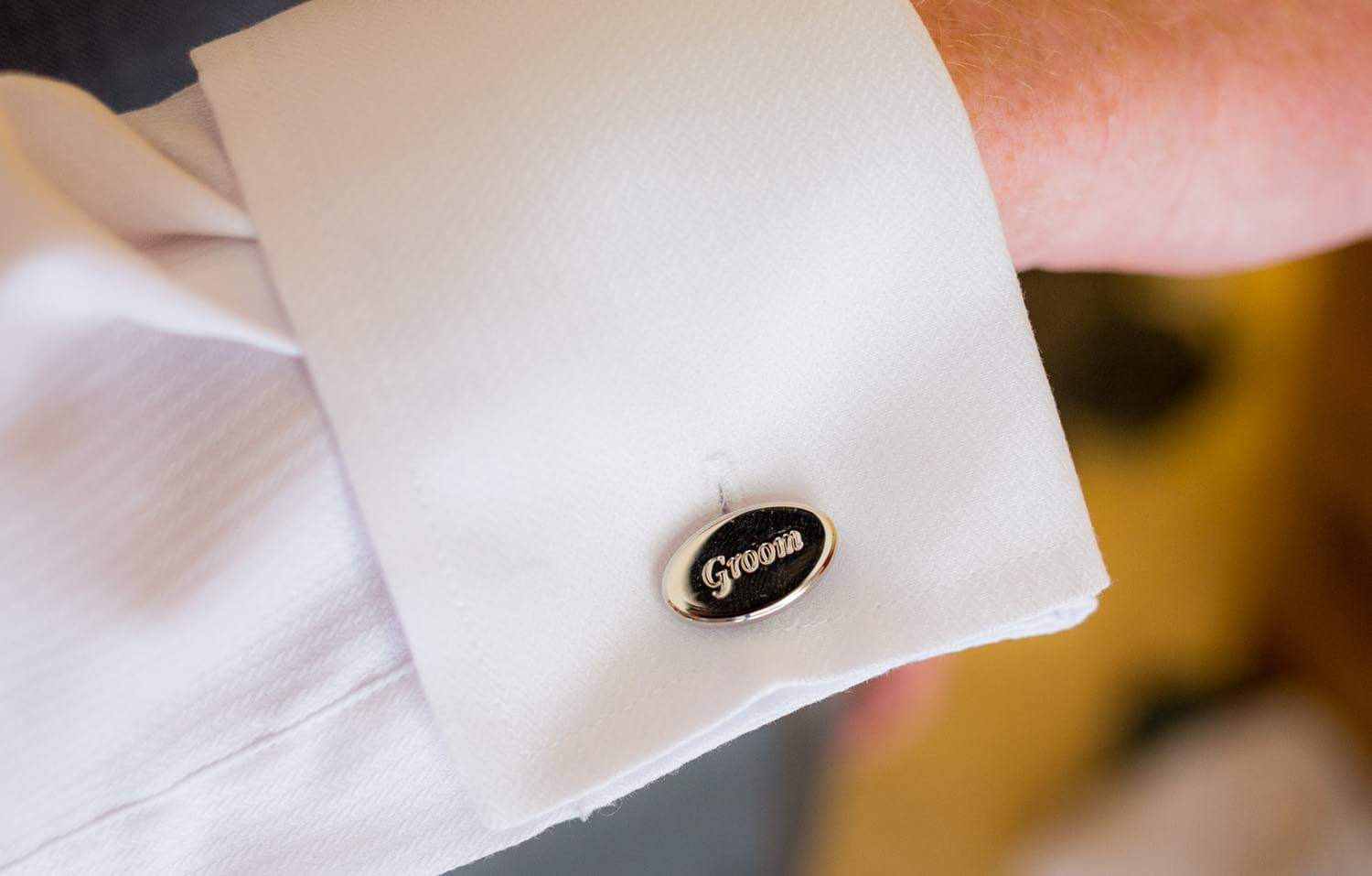 Detail of cufflinks with groom on them at wedding in Mexico