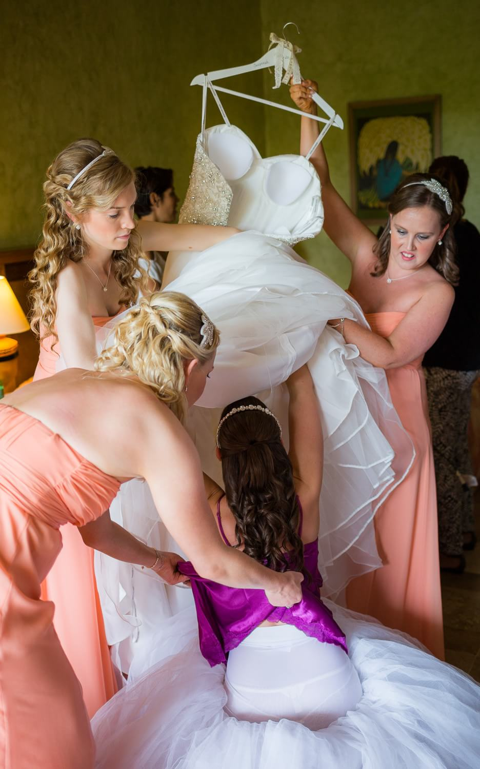 Bride getting into dress at Grand Palladium Riviera Maya Wedding