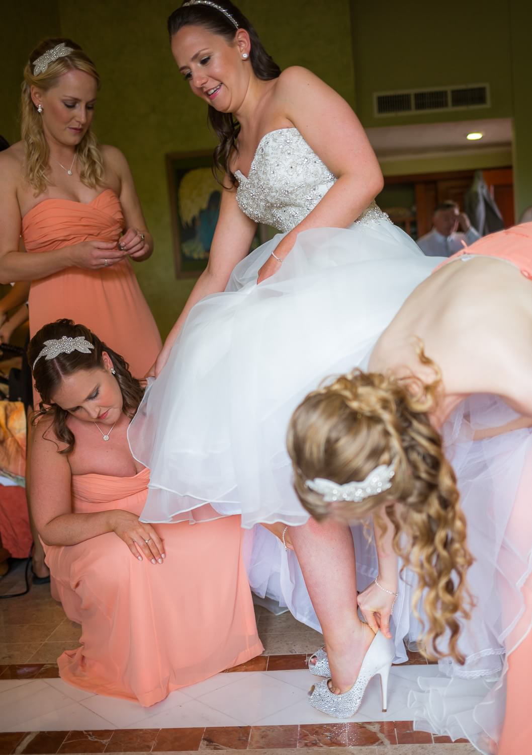 Bride putting on shoes at Grand Palladium Riviera Maya Wedding