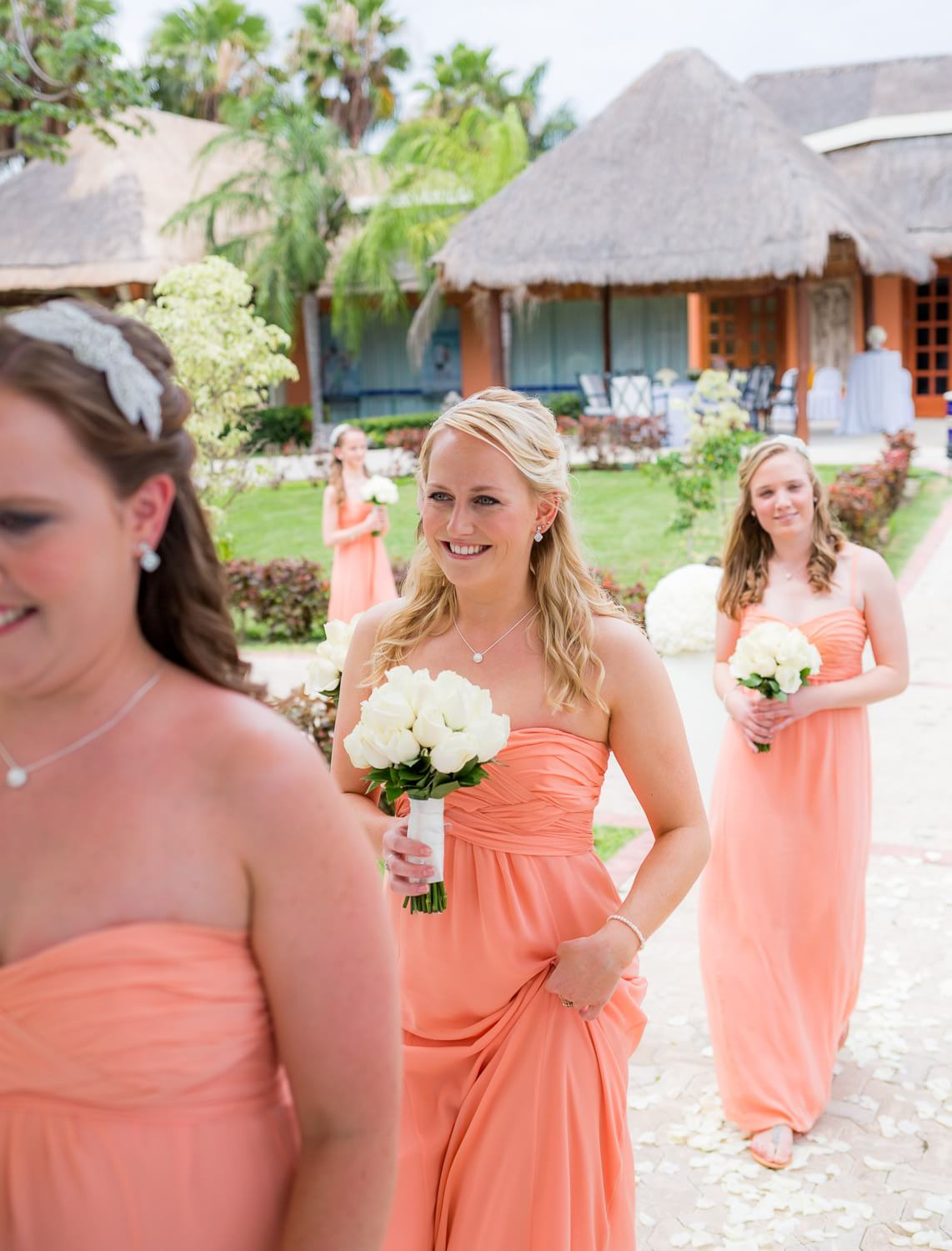 Bridesmaids walking down isle at Grand Palladium Mexico Wedding