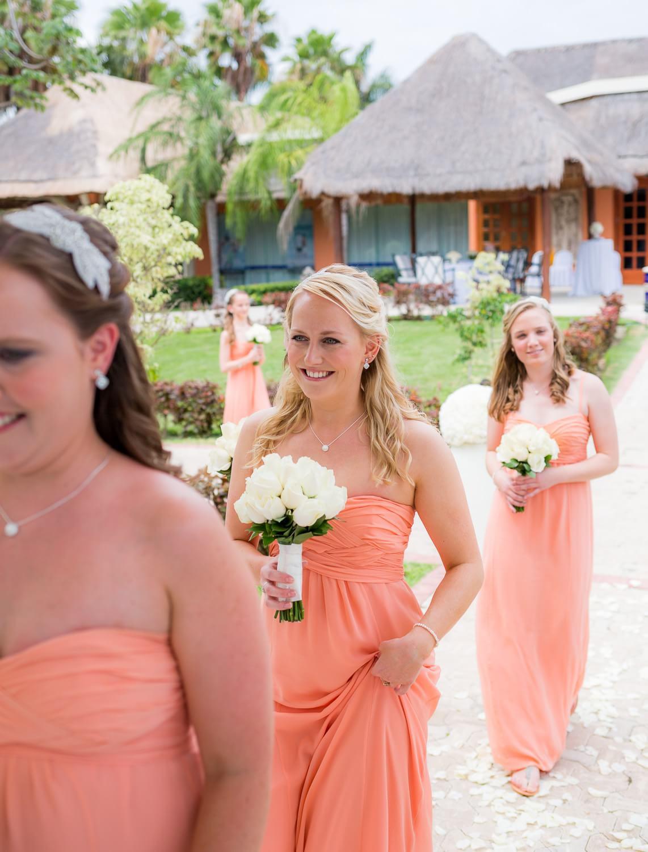 Bridesmaids walking down isle at Grand Palladium Mexico Wedding