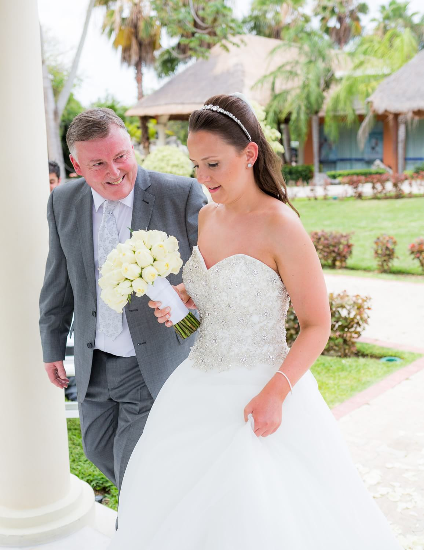 Bride an father walking down ilse at Grand Palladium Mexico Wedding