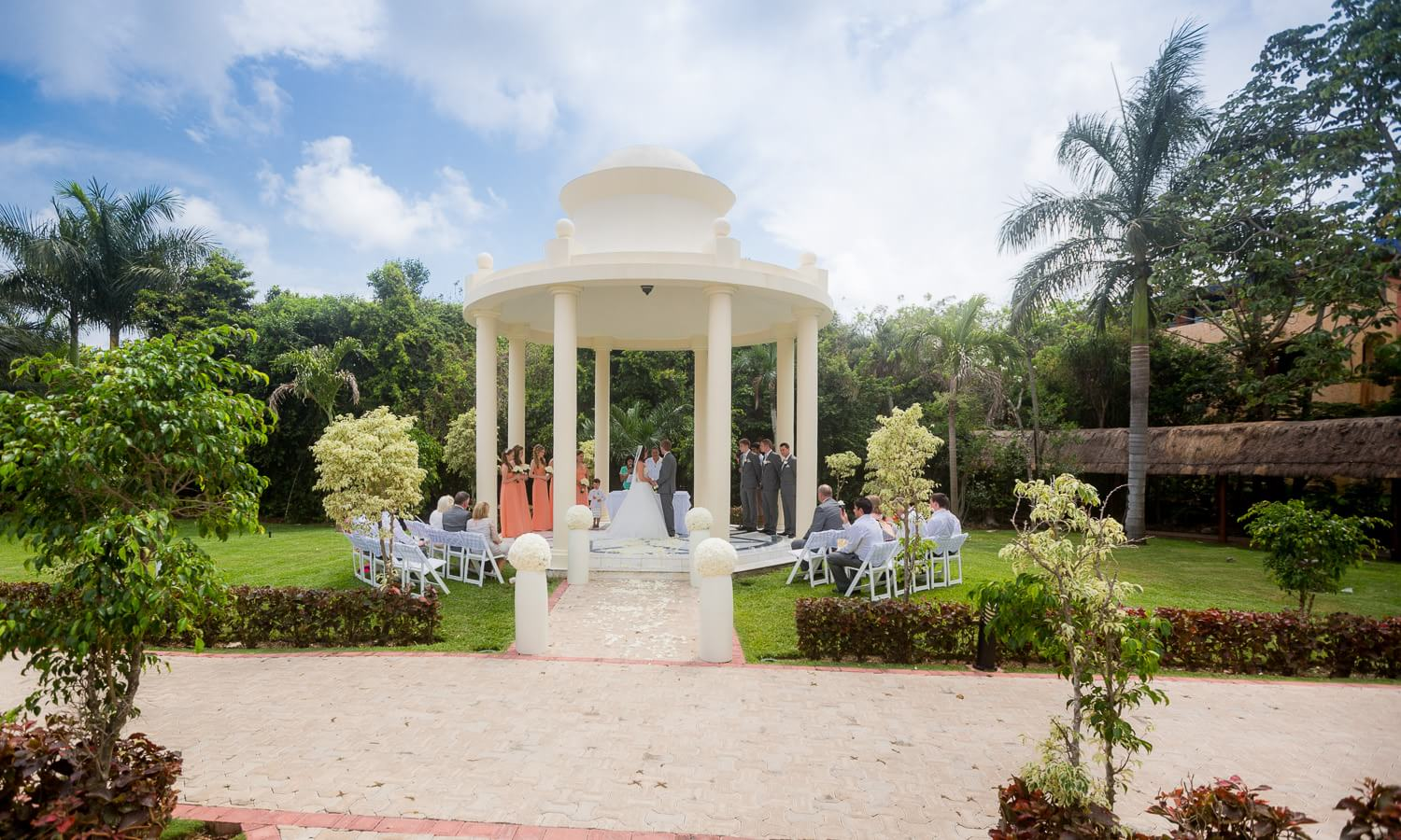 Wedding ceremony in garden at Grand Palladium Mexico Wedding