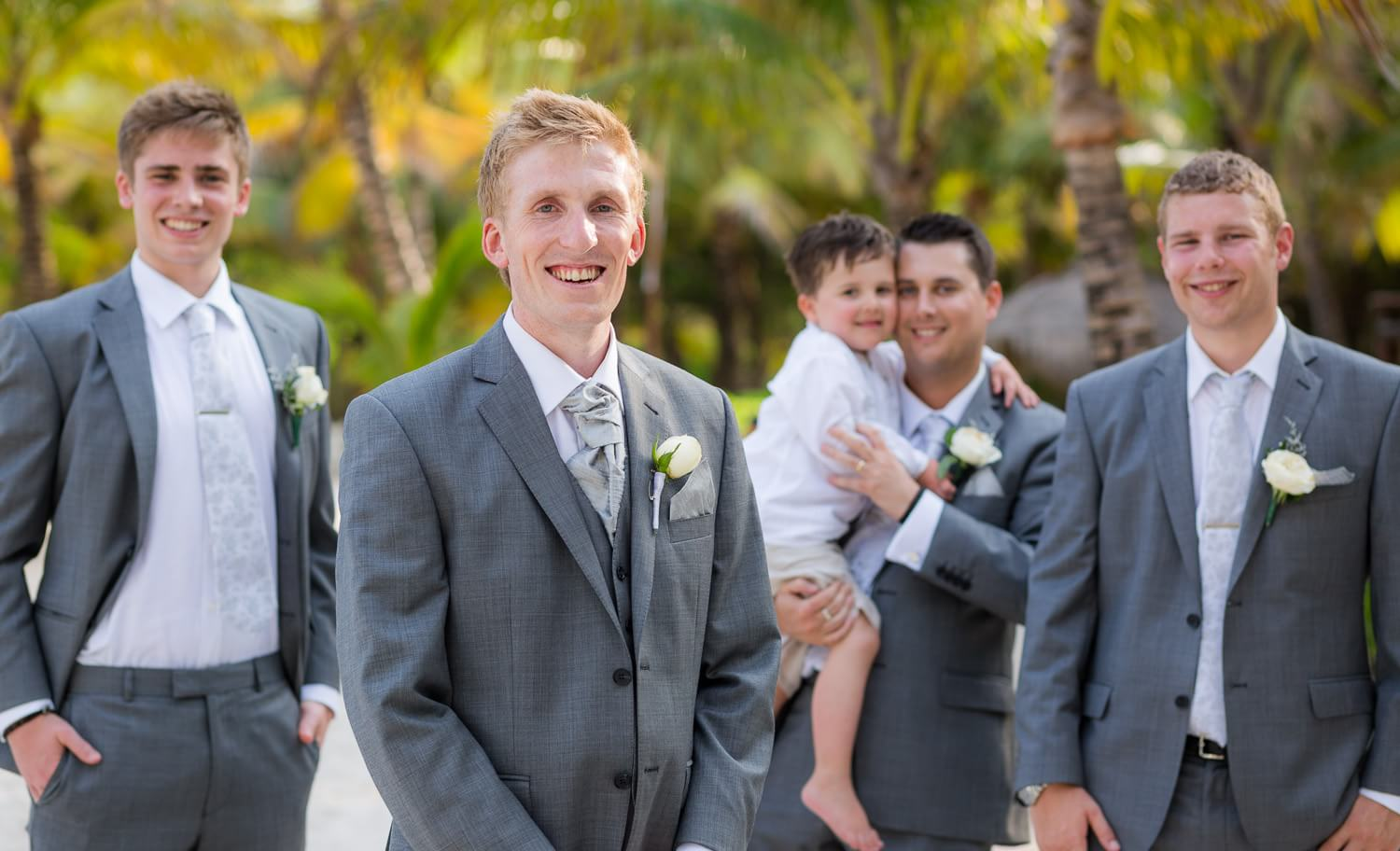 Groomsmen on beach at wedding in Mexico.