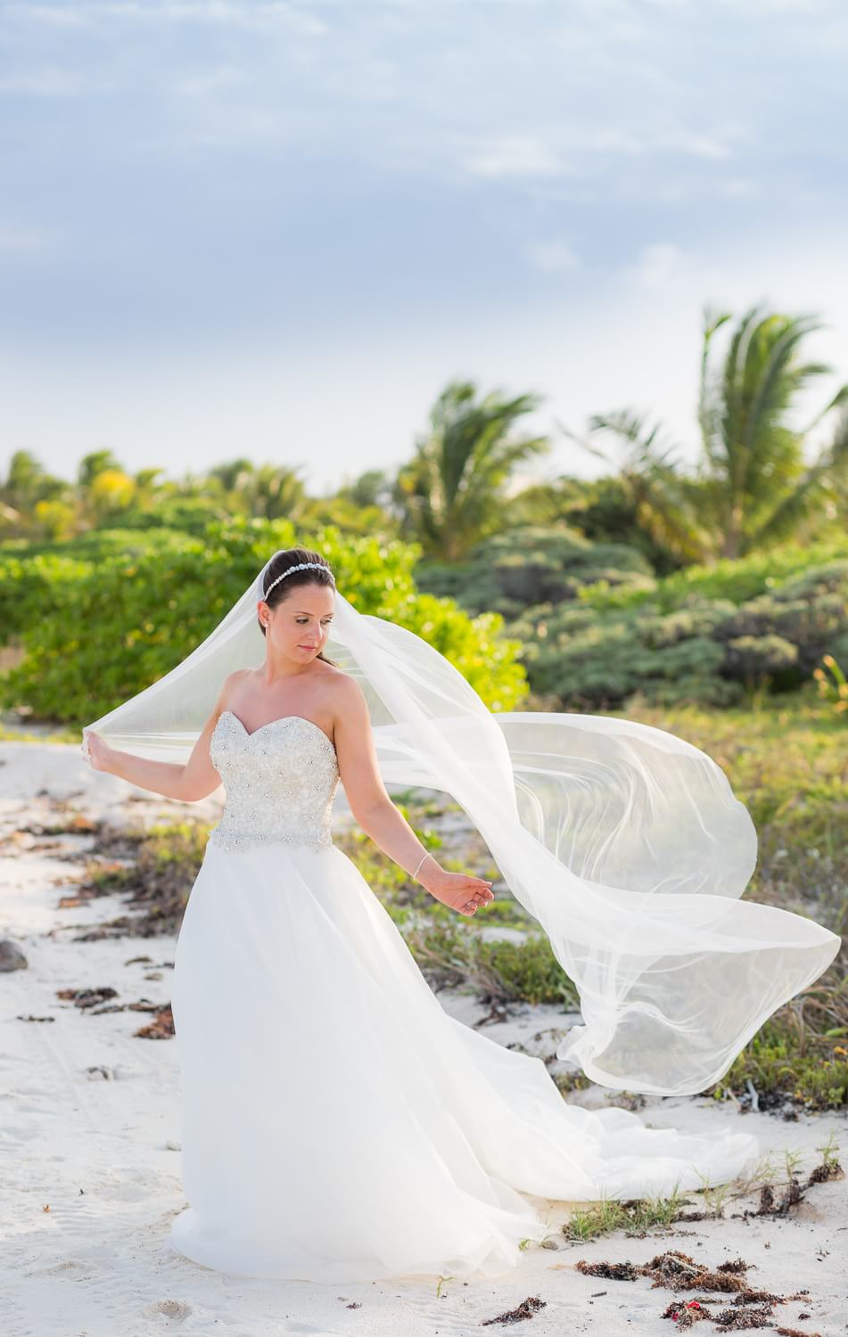 Bride on beach at wedding in Mexico