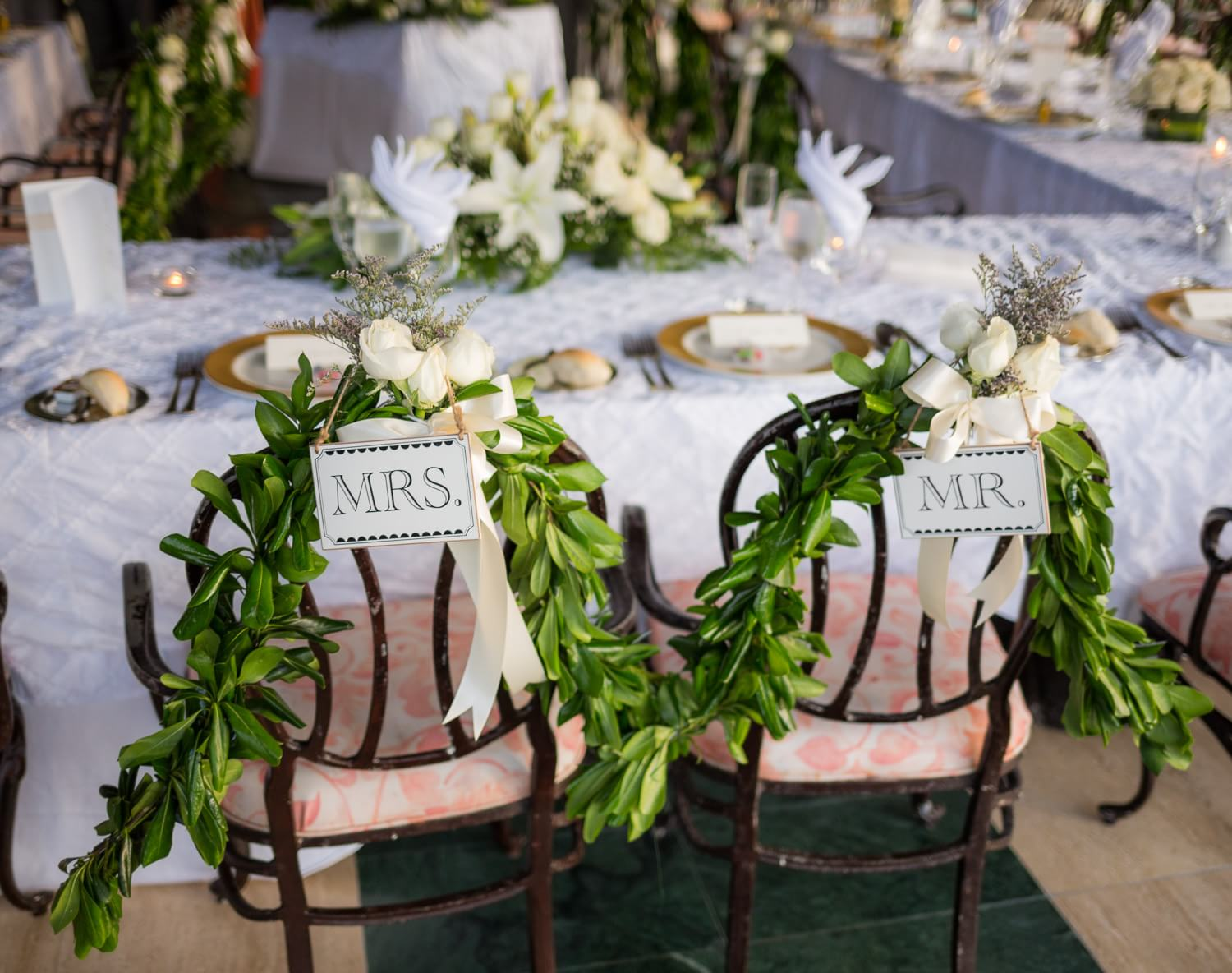 Detail of bride and grooms chairs at wedding.