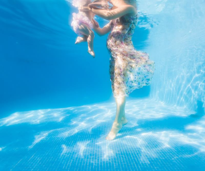baby and feet underwater in Mexico