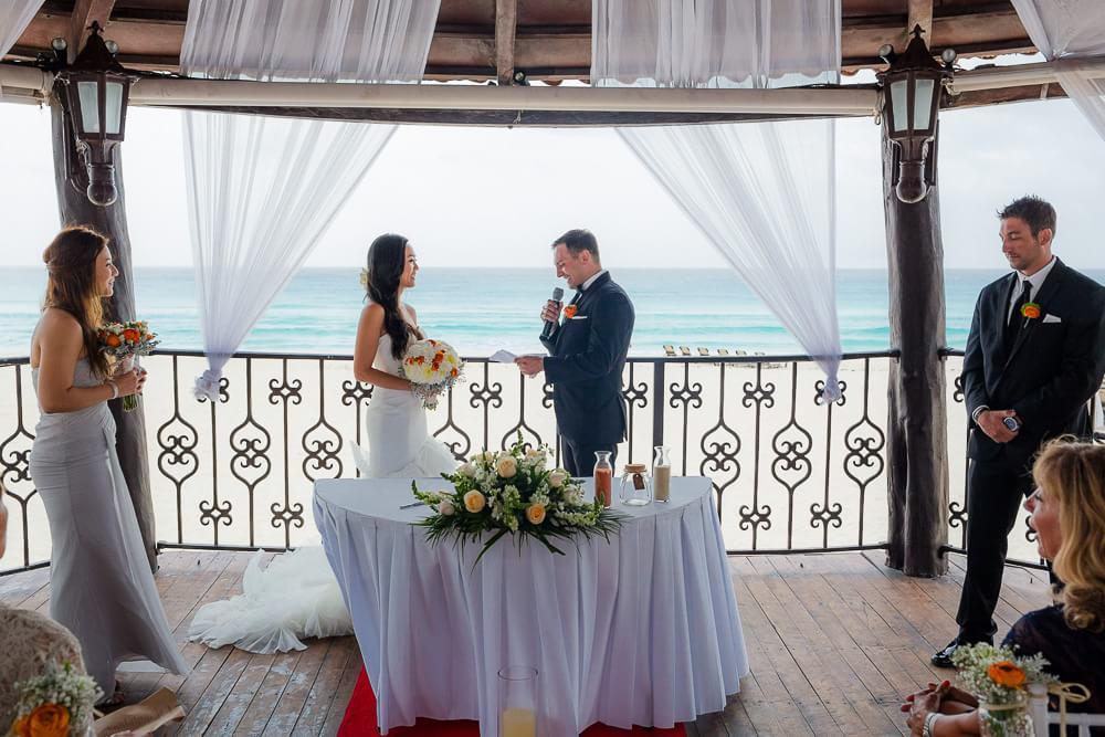 bride and groom at their ceremony at Hyatt Zilara Cancun Wedding