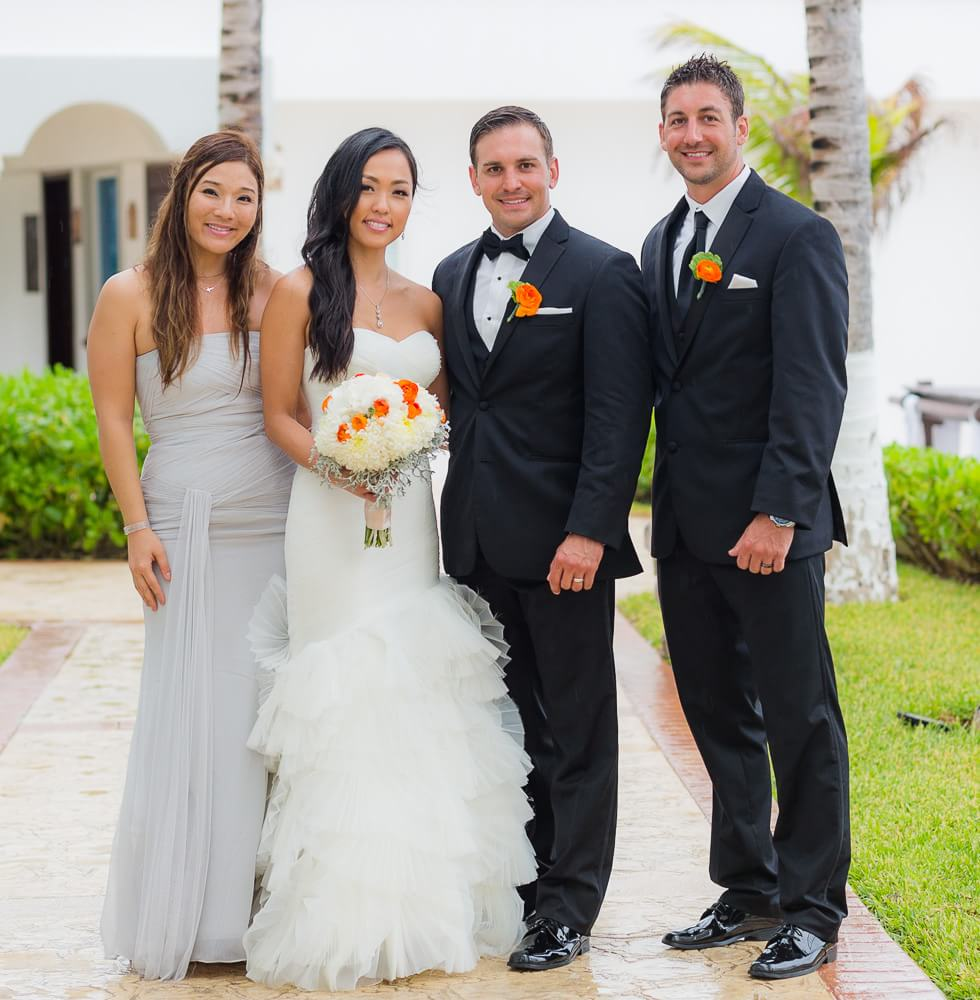 Happy couple with guests at Hyatt Zilara Cancun Wedding