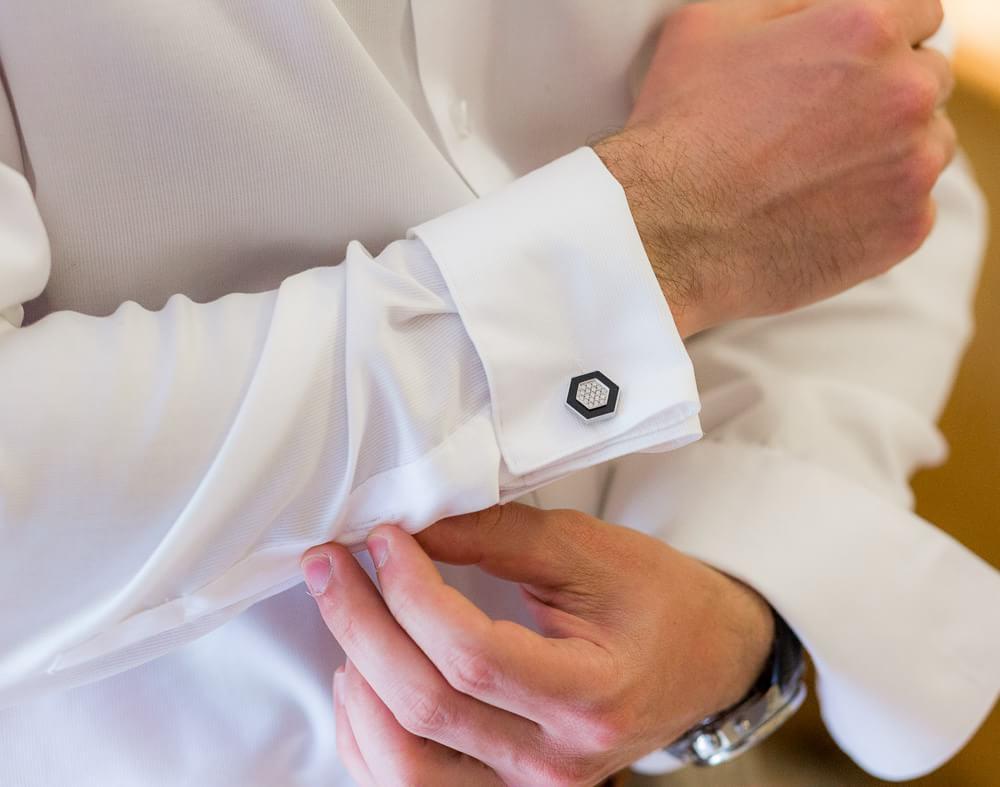Cufflinks of groom at wedding.