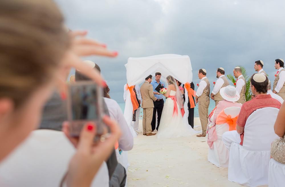Couple under huppa at wedding