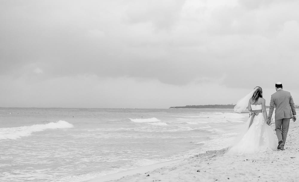 Couple walking on beach at Riviera Maya wedding