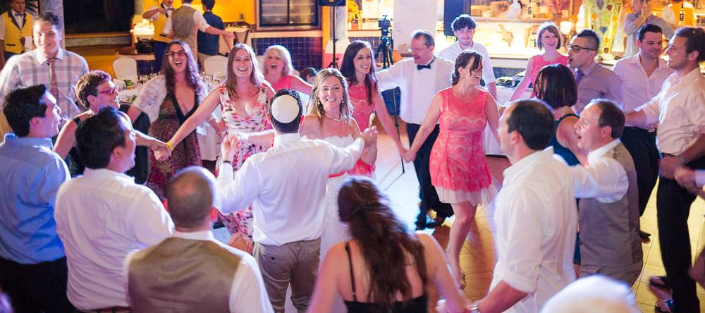 Jewish couple dancing at wedding in Riviera Maya