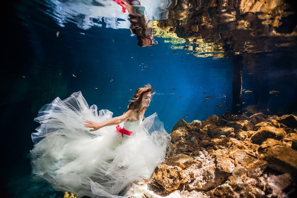 Bride in Mayan Cenote Trash the dress.