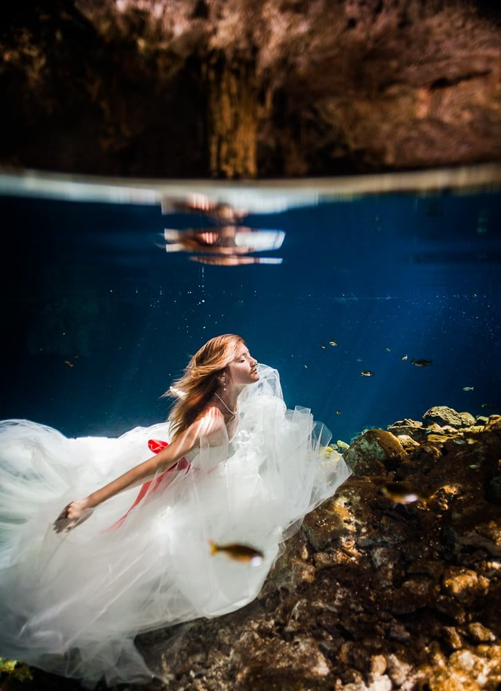 bride underwater in Mexican Cenote Trash the dress